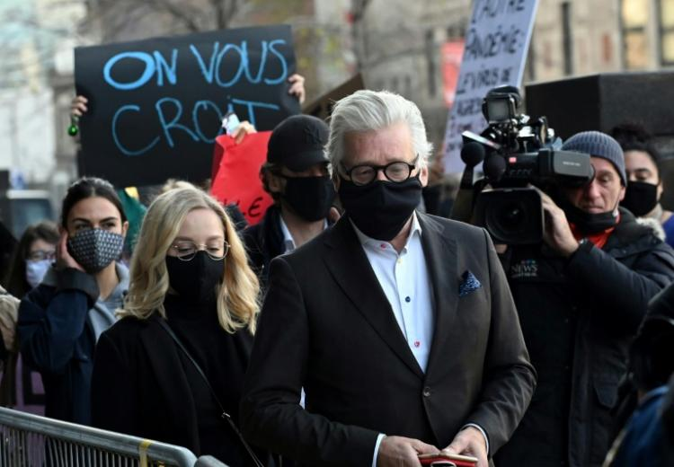 Former Canadian producer Gilbert Rozon (C) arrives for the last day of his trial on charges of sexual assault and harassment, on November 6, 2020, at the Montreal courthouse. Rozon, 65, was charged in December 2018 for events that allegedly occurred in 1980 involving a victim whose identity was not revealed. The Quebec public prosecutor's office did not file charges from 13 other alleged victims.